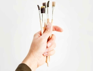 photo of person holding paint brush